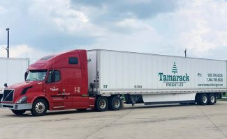Side View of Red Tamarack Freight Semi Truck